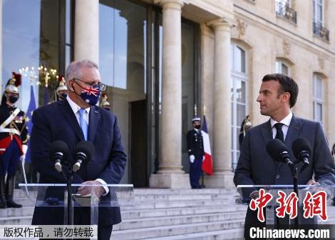 资料图:澳大利亚总理莫里森和法国总统马克龙。